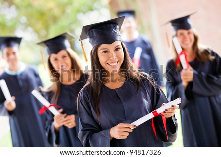 Hispanic Male With Deploma Wearing Graduation Cap and Gown On Ca Stock photo © feverpitch