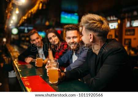 Women and men in sports bar celebrating victory of their team Stock photo © Kzenon