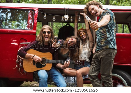 Group of joyous hippies happy men and women laughing, and playin Stock photo © deandrobot