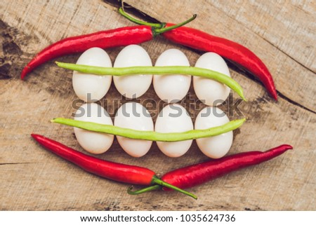 Stock photo: Eggs, peppers, beans and cucumbers in the form of teeth and breakets. varities of orthodontic bracke