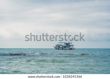 Vietnamese ship with divers and equipment for diving, ready to dive. Stock photo © galitskaya