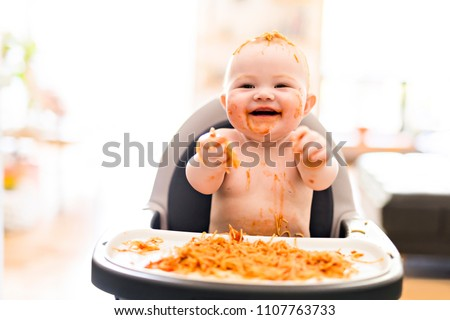 Little baby girl eating her spaghetti dinner and making a mess Stock photo © Lopolo
