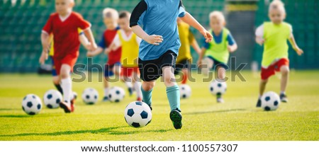 Children Play Soccer Game. Young Boys Running and Kicking Footba Stock photo © matimix