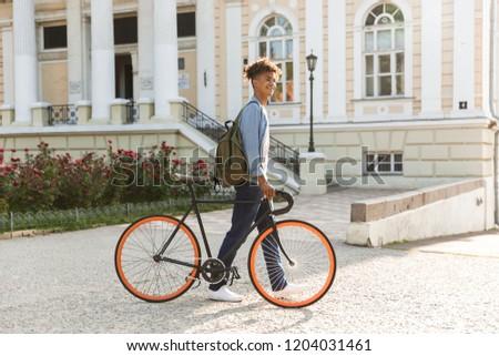 Excité jeunes africaine Guy marche extérieur Photo stock © deandrobot