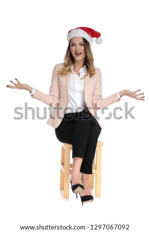 curious businesswoman wearing santa hat makes inviting gesture Stock photo © feedough