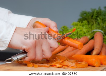 cook cleans carrots Stock photo © OleksandrO