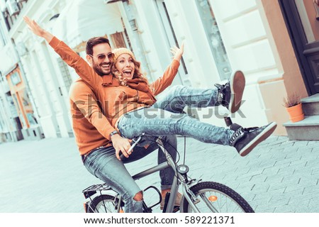 portrait of beautiful couple man and woman riding on motorbike stock photo © deandrobot