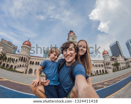 Boy on background of Sultan Abdul Samad Building in Kuala Lumpur, Malaysia. Traveling with children  ストックフォト © galitskaya