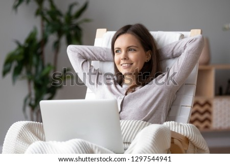 Businesswoman Using Laptop Sitting Behind The Air Conditioner Stock photo © AndreyPopov