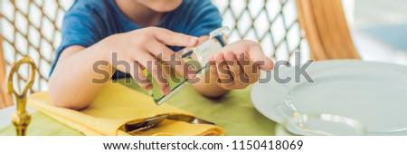 Boy using wash hand sanitizer gel in the cafe BANNER, long format Stock photo © galitskaya