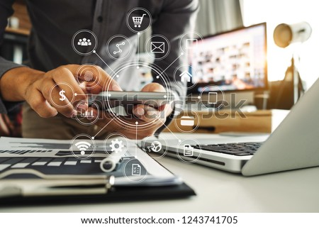 businessman hand working with digital computer and smart phone w stock photo © Freedomz