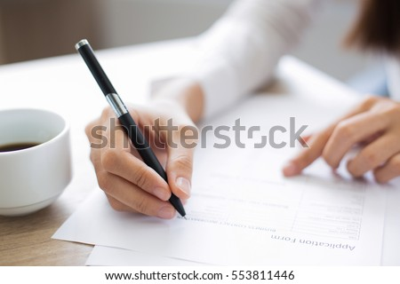 Closeup of woman applicant writing in resume form, person comple Stock photo © Freedomz