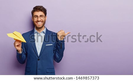 Smiling businessman being happy about prosperous business growth Stock photo © lichtmeister