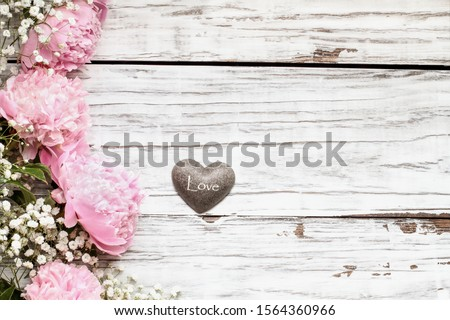 Heart with Pink Peonies and Babys Breath Flowers over a Rustic W Stock photo © StephanieFrey