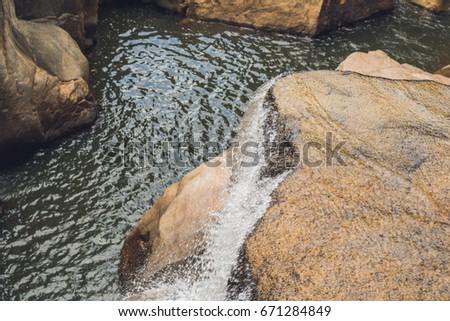 Turquoise water of the mountain river Ganges among white smooth stones. Gangotri. Uttarkashi distric Stock photo © galitskaya