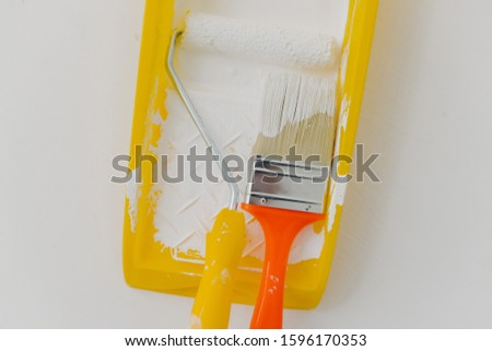 Top view of paintroller and paintbrush in tray over white background. Refurbishment, repairing and d Stock photo © vkstudio