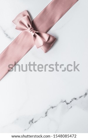 Beige silk ribbon and bow on marble background, glamour present  Stock photo © Anneleven