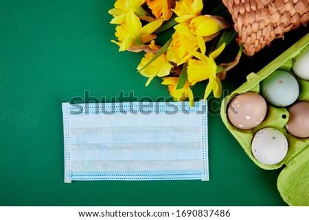 easter symbol eggs near protective medical masks due to coronavirus epidemic stock photo © illia