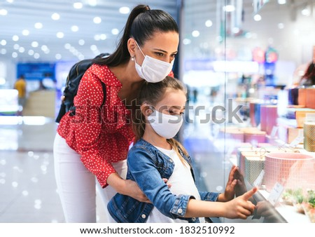 Mother with daughter child in mask looking from window, coronavirus. Stock photo © Illia
