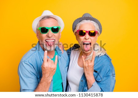 Photo of woman making horns with fingers and sticking out her tongue Stock photo © deandrobot