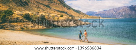 New Zealand travel people tourists visiting Otago region walking on shore of lake Hawea nature lands Stock photo © Maridav
