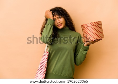 Portrait of young beautiful awake woman with gifts surrounding h Stock photo © HASLOO