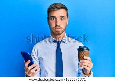 Portrait of a young man drinking coffee and breathing the smell Stock photo © HASLOO