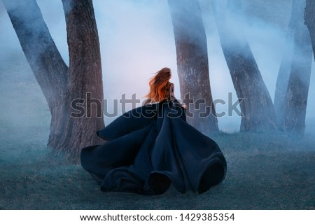 Mystic and beautiful young woman in red silk on blue background Stock photo © adamr