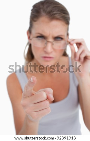 Unhappy woman pointing at the viewer against a white background Stock photo © wavebreak_media