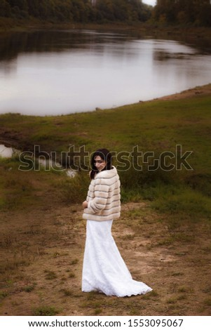 Elegance. Charming Autumn Brunette in Fur Coat in her Thoughts stock photo © gromovataya