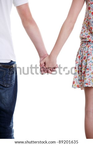 Closeup of young affectionate couple holding hands over white ba Stock photo © dacasdo