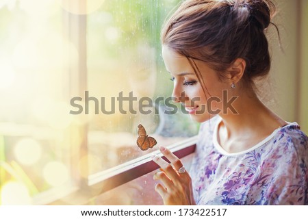 young brunette girl with beautiful smile and butterfly sitting on orchid flower in her hair stock photo © nejron