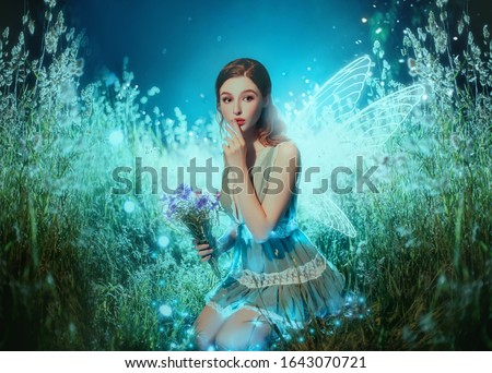 Young beauty with butterfly face-art and bouquet of sunflowers Stock photo © Nejron