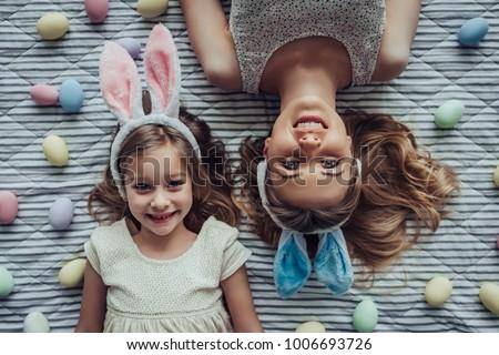 Gyönyörű nő nyuszi fülek asztal csukott szemmel tavasz Stock fotó © deandrobot