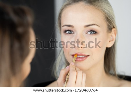 beautiful woman with makeup brushes near her face casually leani stock photo © victoria_andreas