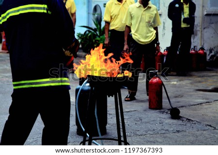 Man hand using fire extinguisher with head spray, safety concept Stock photo © FrameAngel