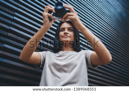 Concentrated woman photographer processing pictures using graphic tablet in office Stock photo © deandrobot