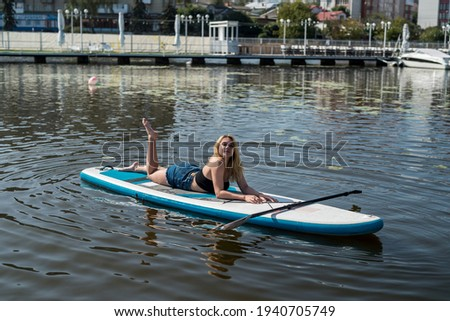 surfer girl close to water on city beach stock photo © kzenon