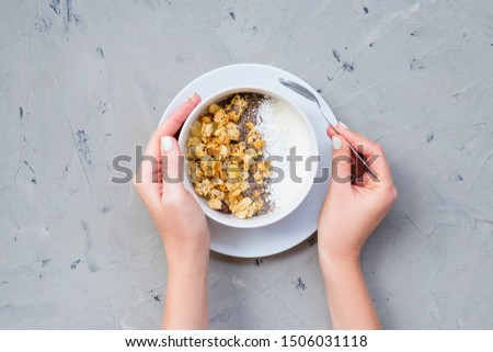 chia seeds in the white plate with spoon on the dark stone table vertical stock photo © karpenkovdenis