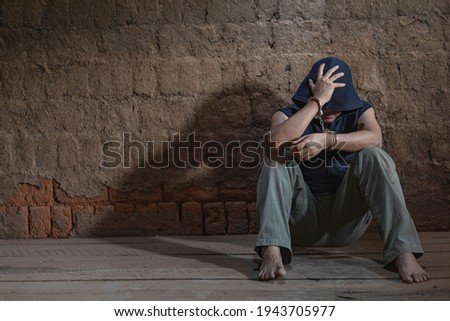 Arrested male criminal with handcuffs facing prison wall Stock photo © stevanovicigor