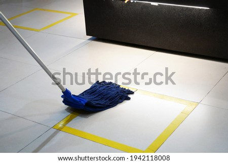 Woman cleaning toilet using loo brush Stock photo © Kzenon