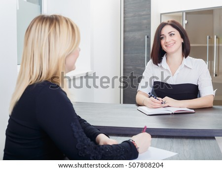 two businesswoman one blond lady and one young woman shaking h stock photo © nikodzhi