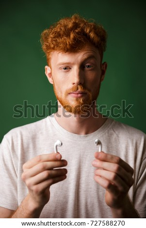 Close-up portrait of curly redhead man with raised eyebrow, show Stock photo © deandrobot