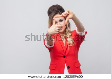 Picture of beautiful woman in red blazer standing and fooling around with documents Stock photo © Traimak