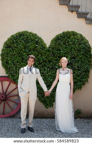 Ifjú pár szív alakú bokor öltöny férfi Stock fotó © IS2
