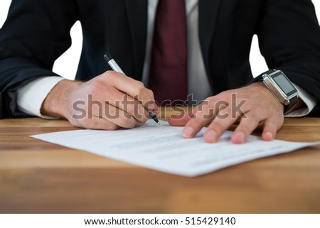 Stock photo: Businessman filling last will and testament form against white background