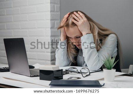 Stock photo: Portrait of confident beautiful young tired business woman covering her eyes with hands on yellow ba
