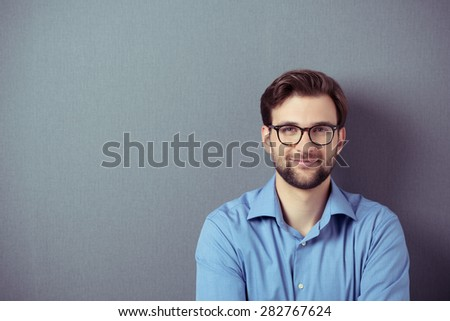 confident elegant young businessman standing on grey background Stock photo © feedough