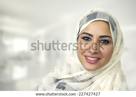 Portrait of beautiful serious young muslim woman wearing black hijab with hands near her face as pra Stock photo © Traimak