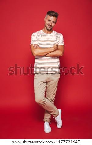 Kép pozitív férfi 30-as évek csíkos póló Stock fotó © deandrobot